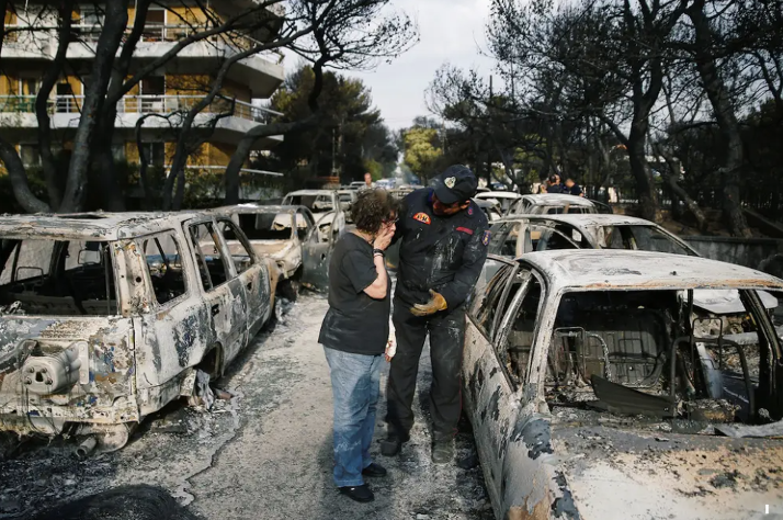 Figure 8: A Woman tries to find her dog in Mati. (Source https://www.insider.com/greece-wildfire-outside-athens-worst-since-2007-at-least-50-dead-2018-7)